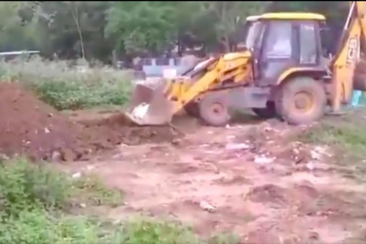 JCB tractor being used to move deceased COVID19 victim in Andhra