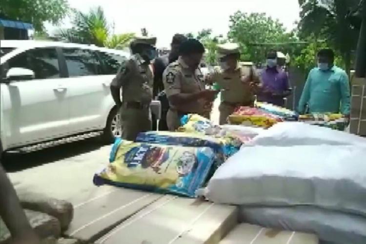 Andhra Pradesh police conducting a check at a border checkpost