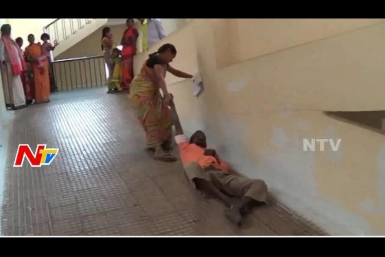 Denied stretcher at hospital Andhra woman forced to drag husband up the ramp