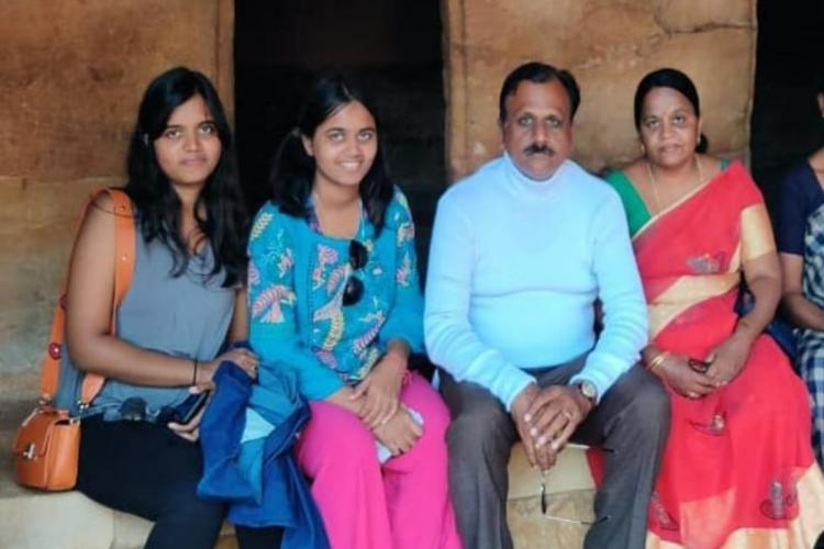 Family photo of Padmaja and Purushotham with their daughters