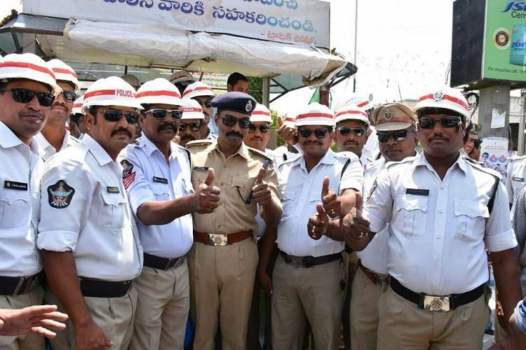 Andhra police bets on chocolates and roses after hefty fines fail to enforce safe driving