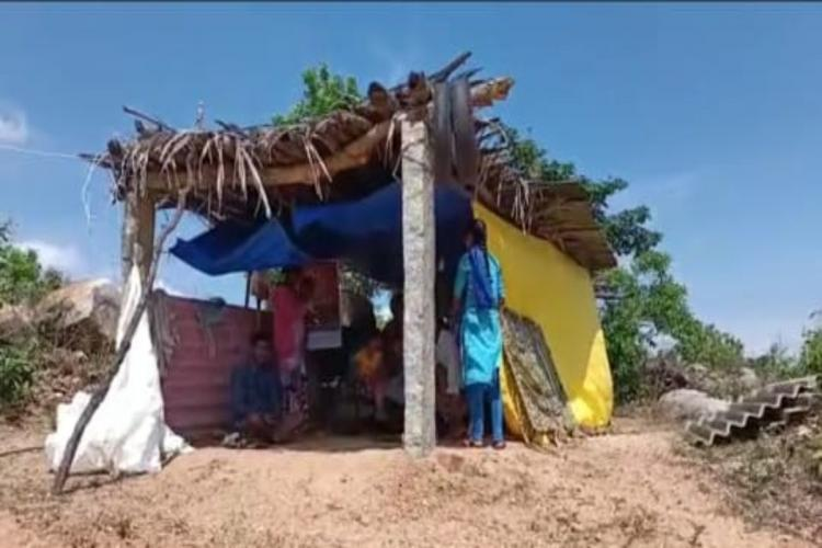 A family staying in a makeshift shelter in Moram village Chittoor Andhra Pradesh