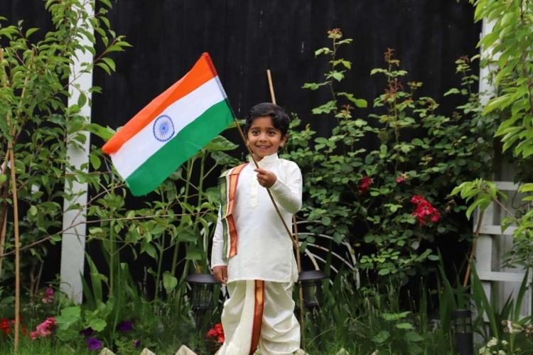 Aneeshwar Kunchala an indian origin Telugu boy from Andhra Pradesh in the UK holding up the Indian flag