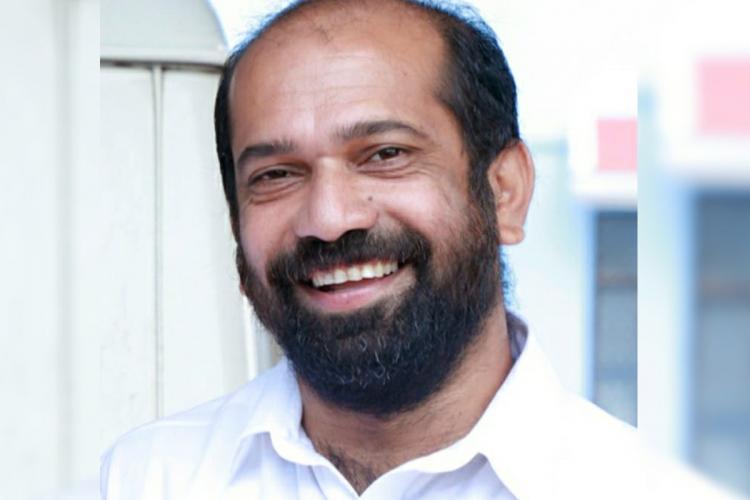 MLA Anil Akkara smiling
