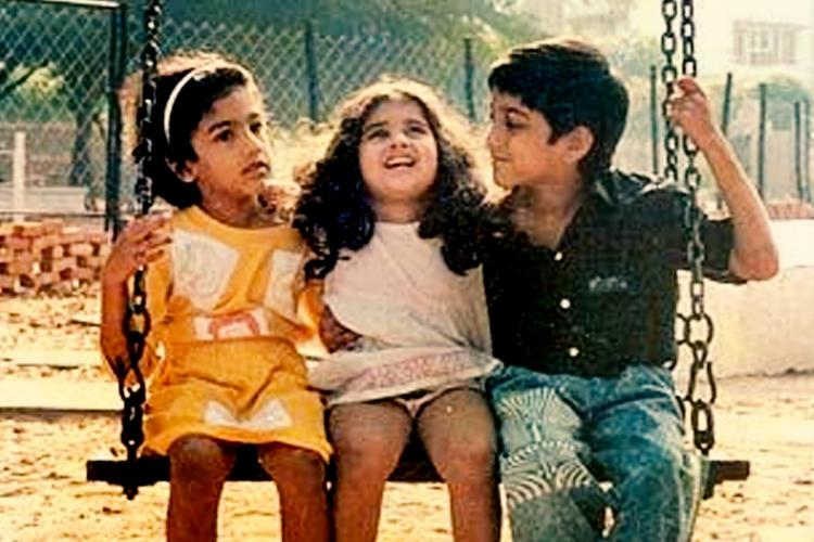 Anjali on a swing with her elder sister and brother in Mani Ratnams Tamil movie Anjali