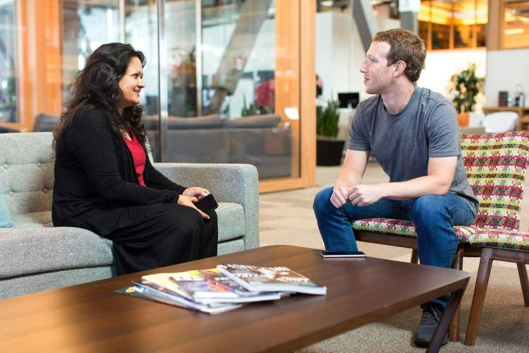 Ankhi Das and Mark Zuckerberg in a coversation sitting on two separate couches facing each other