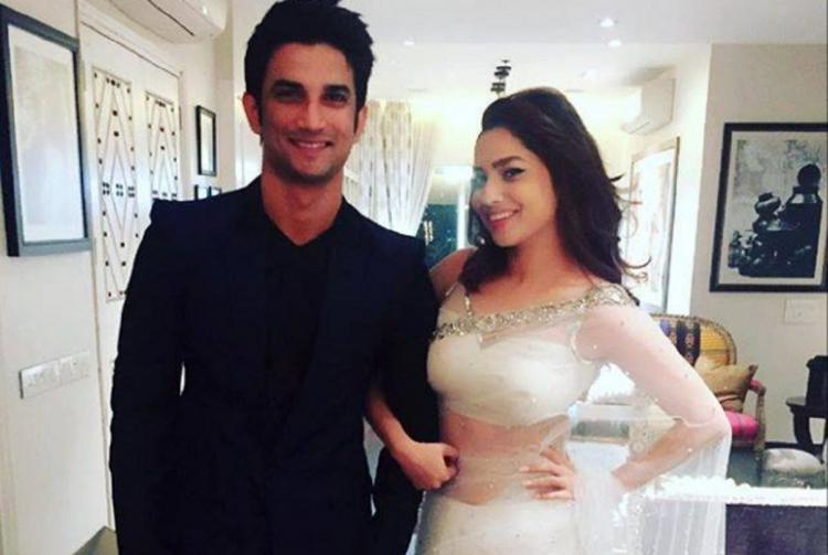 Sushant Singh Rajput dressed in a black suit with his ex girlfriend Ankita Lokhande wearing a white saree