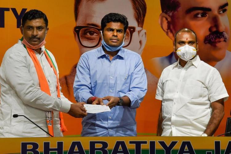 Annamalai joins BJP in presence of Muralidhar Rao and L Murugan