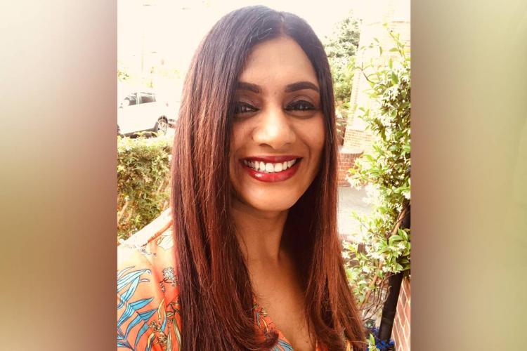 Director Anu Menon smiles