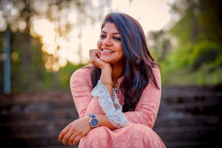 Actor Aparna Balamurali dressed in pink and smiling