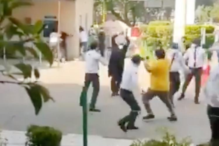 A man is seen hitting a few men with a stick as others try to run away The incident took place at Apollo Hospital in New Delhi