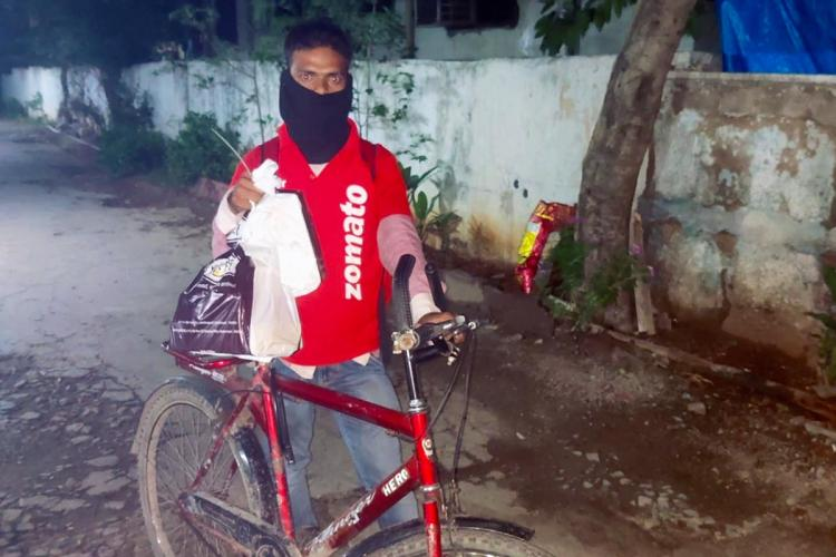 Mohd Aqeel with his bicycle when he came to deliver the order