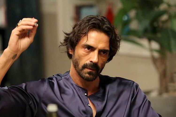 Bollywood actor Arjun Rampal wearing a blue shirt