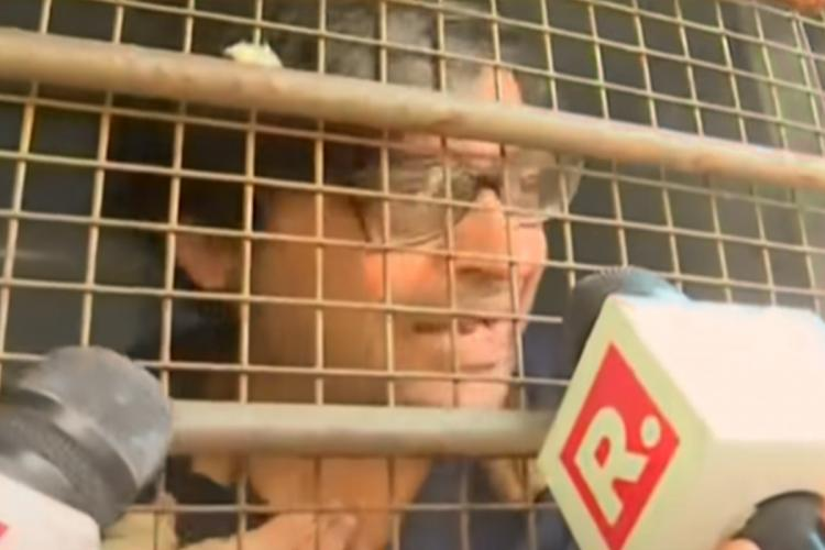 Arnab Goswami inside a police van after his arrest in Mumbai