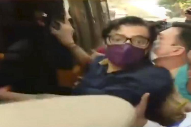 Arnab Goswami wearing a mask arrested by police in Mumbai and is being pushed into police van