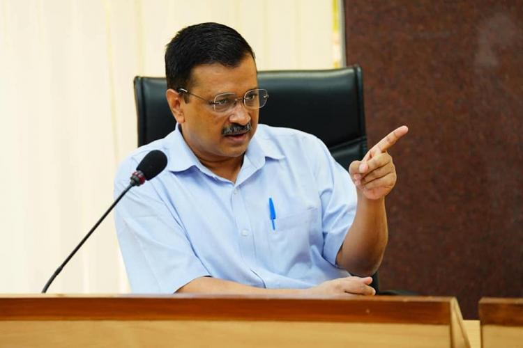 Delhi Chief Minister Arvind Kejriwal points while addressing the media
