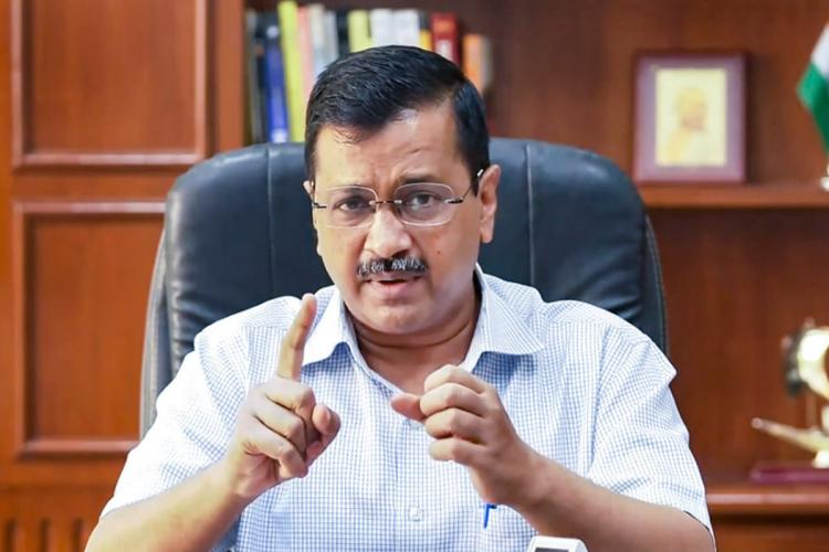 Delhi CM Arvind Kejriwal wearing a light blue shirt and speaking while looking into the camera