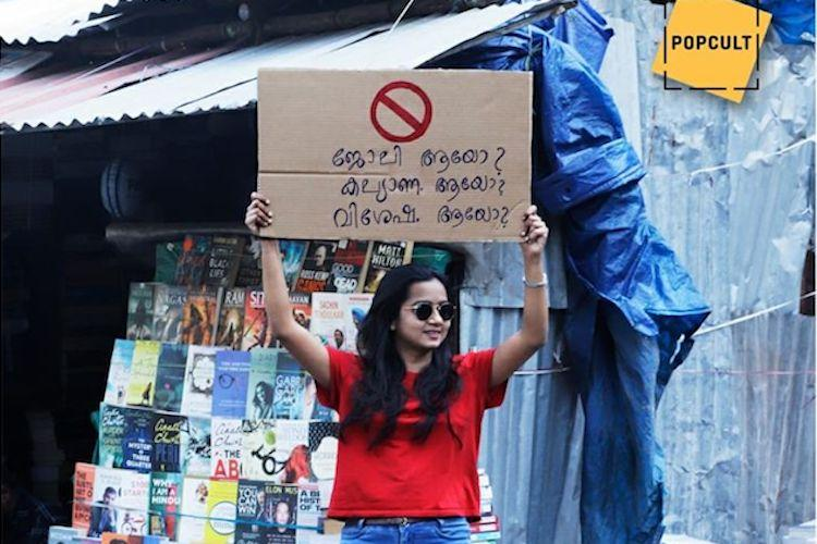 Two women turn heads in Kerala with my bra straps wont burn you and other signs