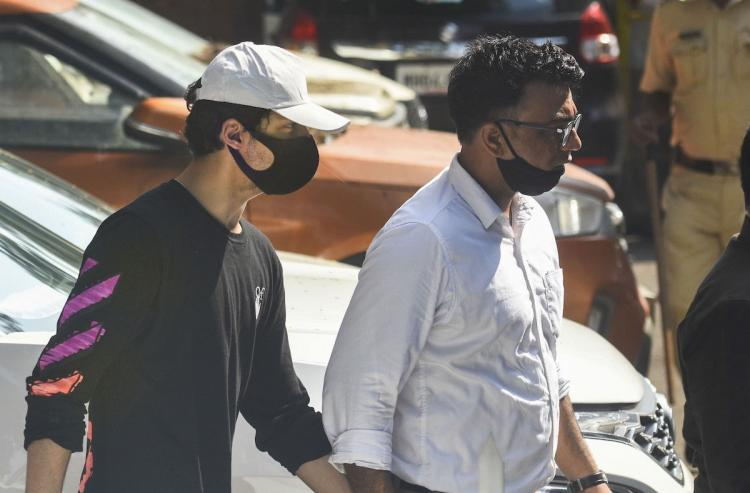 Aryan Khan being escorted by an NCB official