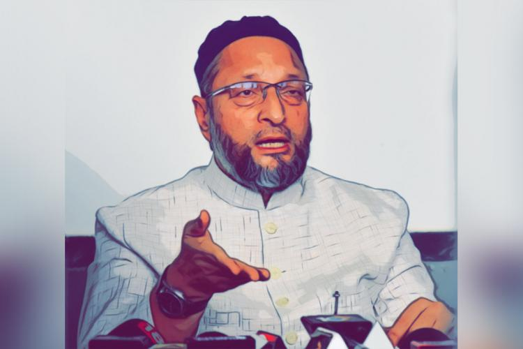 Asaduddin Owaisi dressed in a light grey sherwani with his right hand outstreched while speaking to the media