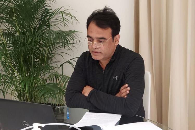 Ashwath Narayanan sitting in front of a laptop