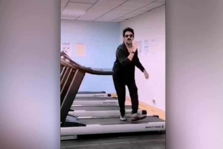 Ashwin KKumar dances on a treadmill in black