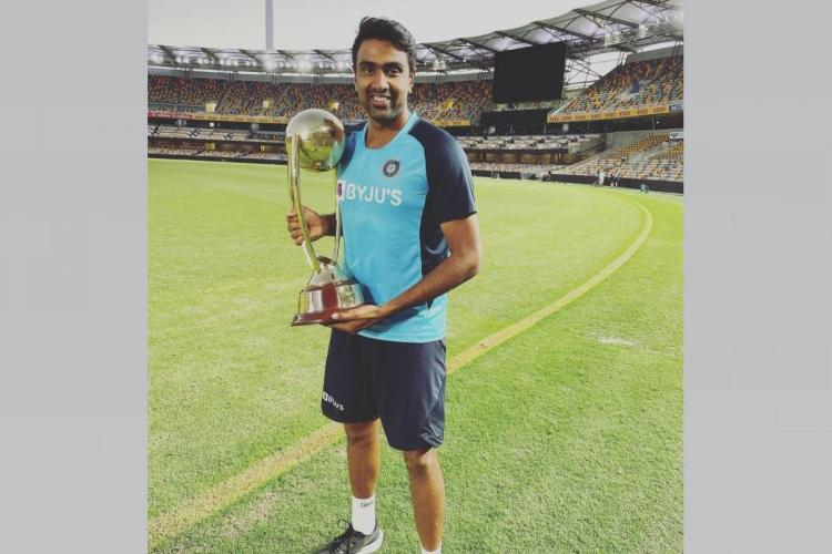 R Ashwin posing with the trophy in Australia