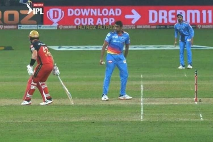 Ashwin gives a warning to Finch for backing up too far