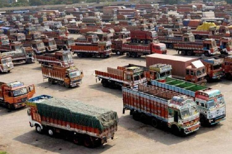 File photo of trucks parked in an open plot
