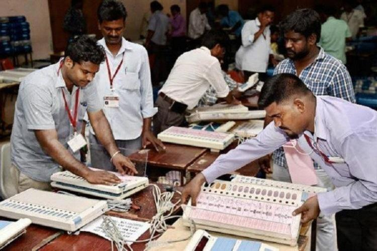 Poll officials arranging ballot boxes for Assembly polls