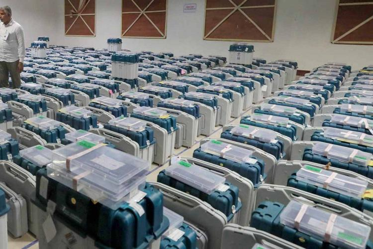 Several EVM machines in a room
