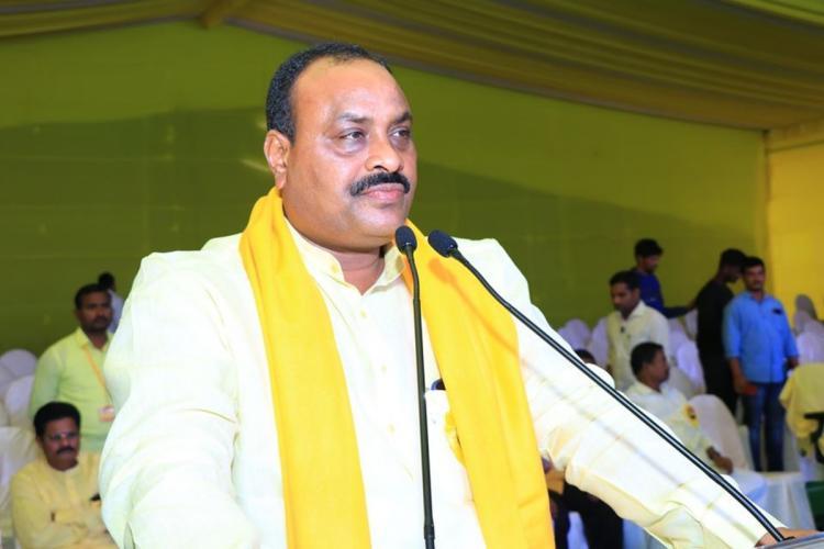 TDP Leader and Tekkali MLA Atchannaidu Kinjarapu in yellow TDP scarf speaking into a mic and addressing public