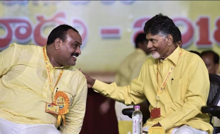 Atchchannaidu and Chandrababu Naidu wearing yellow shirts and were talking to each other