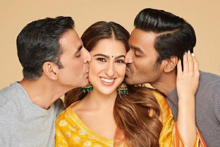 Actor Sara Ali Khan is seen alongside actor Dhanush on the right and Akshay Kumar on the left