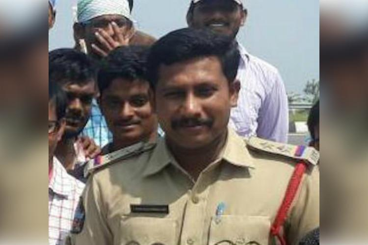 Andhra cop attacked allegedly by extortion gang police launch manhunt to nab culprits