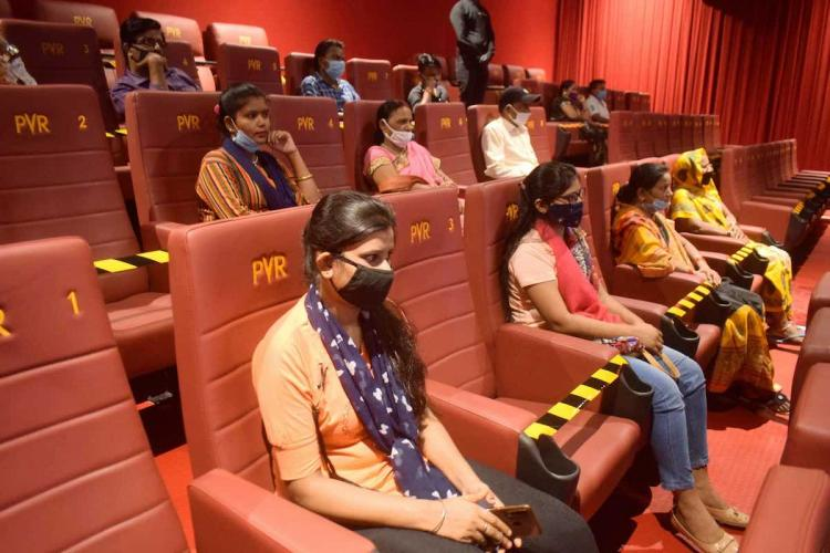 Audience seated in a manner following social distanicing norms at a cineplex that was reopened after closure for months owing to COVID-19 pandemic in Prayagraj Thursday Oct 15 2020 Theatres and multiplexes reopened in some parts of the country after allowed to resume operations as per guidelines issued under Unlock 5