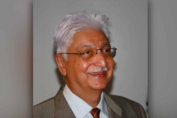 Azim Premji looking away from camera and smiling
