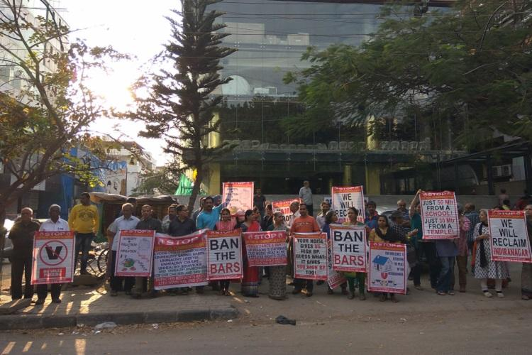 Following inaction by authorities Bengaluru residents protest against illegal bar