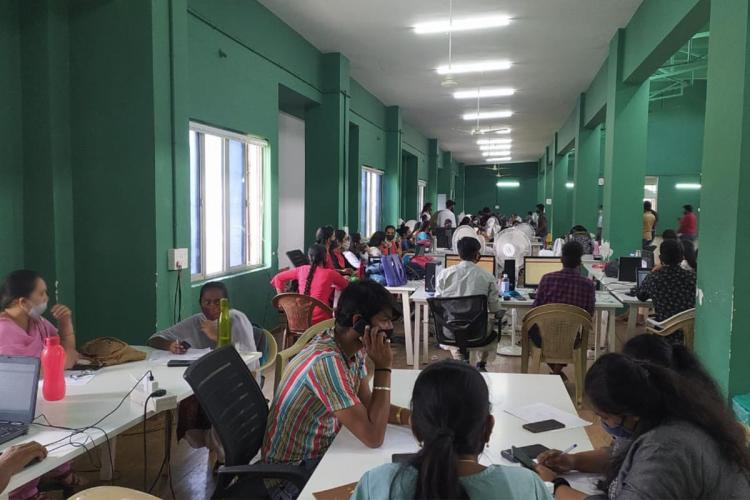 A lot of people speak on phones in the BBMP South zone war room in which BJP MP Tejasvi Surya created a ruckus recently