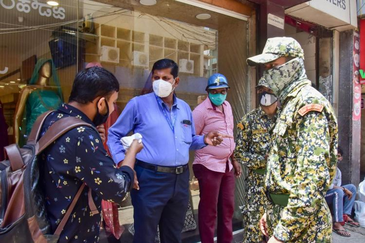 BBMP Marshals ensuring COVID-19 protocols are followed in crowded spaces interacting with people