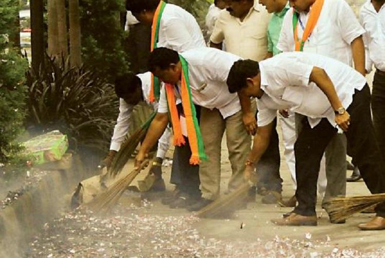 Bluru Congress workers celebrate after Mayor poll win BJP corporators sweep up the mess after