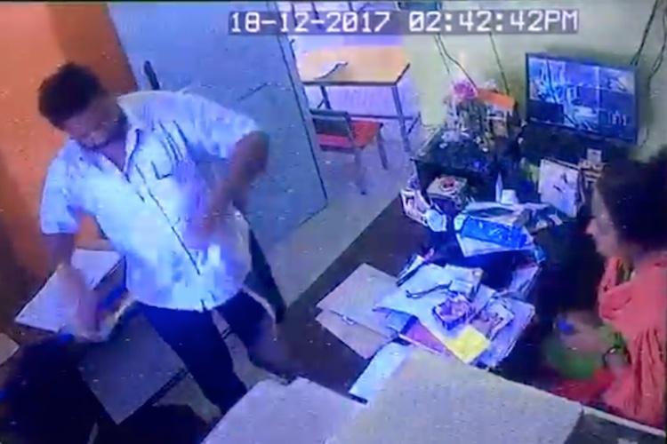 Shocking video Money lender slaps thrashes Ktaka school principal with cycle chain