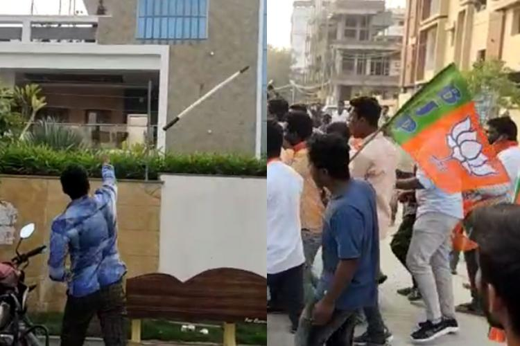 A BJP worker throws a stick at the MLAs house