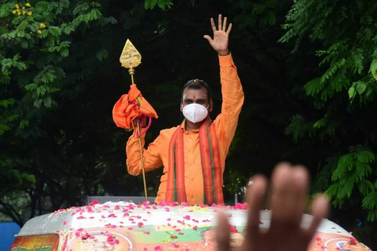 BJP Tamil Nadu President L Murugan with a vel during the vetrivel yatra