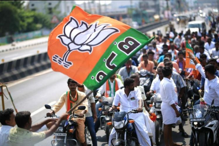 BJP supporters take out a rally in Tamil Nadu. They are bike-borne and waving the BJP party flag.