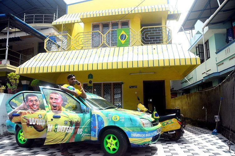 World Cup frenzy Kerala man paints his house vehicles in Brazil colours