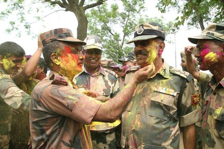 In pics Indian and Bangladeshi soldiers enjoy Holi bonhomie at Agartala-Akhaura border