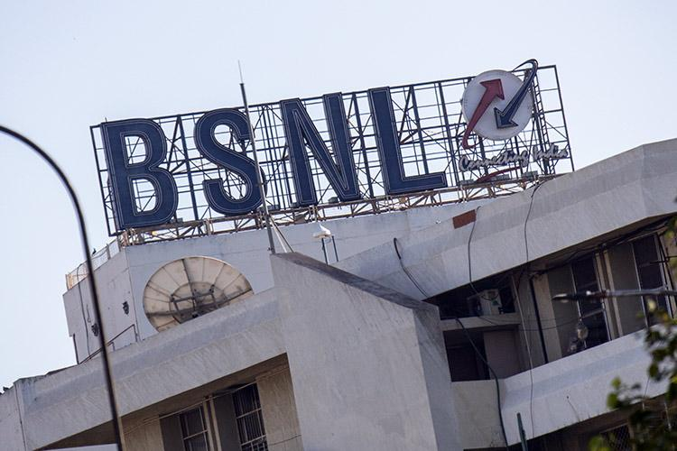 The BSNL logo on top of a building against the backdrop of the sky
