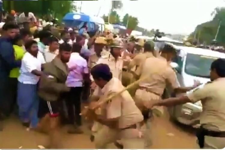 Karnataka floods Cops lathicharge flood-hit locals who stalled CM BSYs convoy