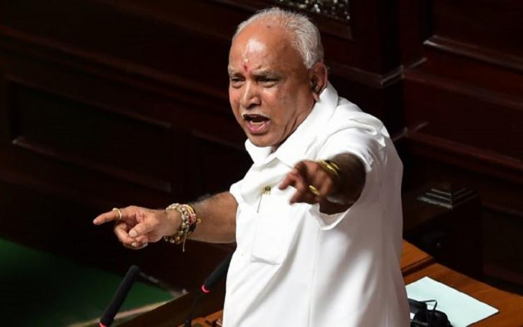 BS Yediyurappa in the Karnataka Assembly. He is pointing fingers as he seems to be arguing.